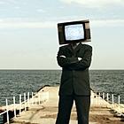Мужчина <b>с</b> <b>телевизором</b> вместо головы гифка анимация